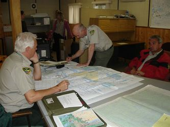 Photo from MNR - Crews planning fire fighting efforts.