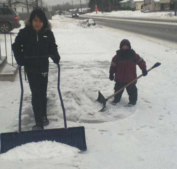Laureen and Darius shovel the snow