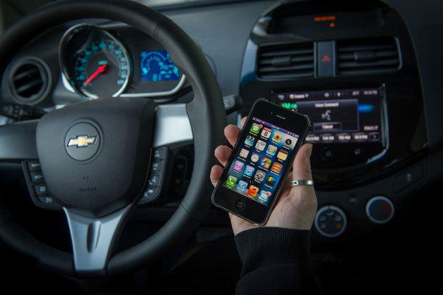 Customers with a compatible iPhone running iOS 6 can direct Siri to perform tasks while they safely keep their eyes on the road and their hands on the wheel. (Photo by Steve Fecht for Chevrolet)