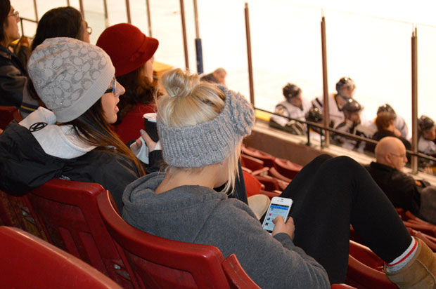 Teens on their Iphones while watching the SIJHL is very common