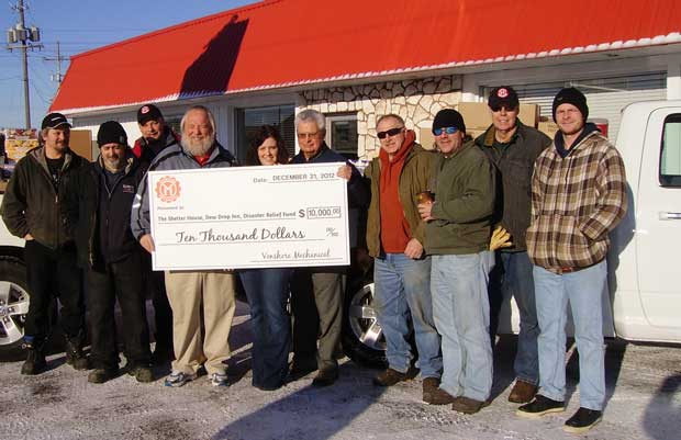 Venshore Manufacturing Inc workers with cheque presentation to Wayne Fletcher
