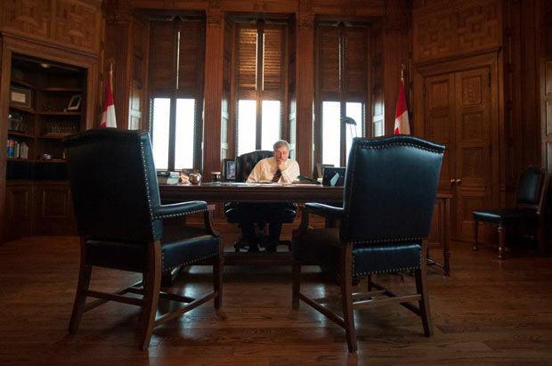 Prime Minister Harper in what could be a telling image of how it is lonely at the top