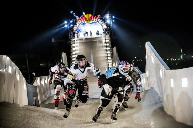 Kyle Croxall of Canada races with Scott Croxall of Canada, Cameron Naasz of the United States and Kim Muller of Switzerland during the finals of the Red Bull Crashed Ice, the Ice Cross Downhill World Championship 2013, in Saint Paul, Minnesota, United States on January 26, 2013.