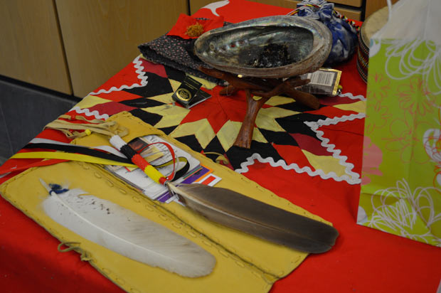 Indigenous women Elders The Eagle Feathers and Smudge along with tobacco at City Hall - Image taken with permission