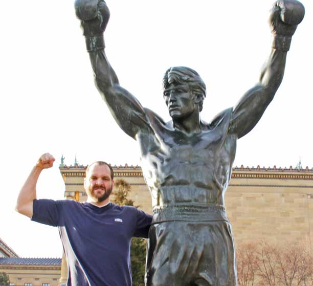Devon Nicholson and Rocky Statue