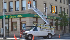 tbaytel crew working on Eye in the Sky camera at May and Victoria corner