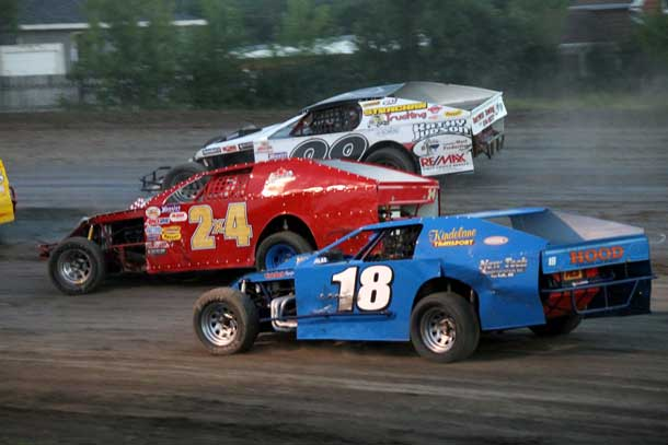 #18 Bill Reimer, #2X4 Ken Perry, and #99 Brody Strachan battled it out during the WISSOTA Midwest Modified feature which had several three and four wide battles throughout the 20 lap feature.