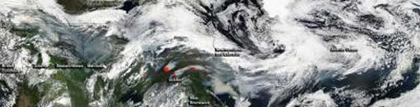 NASA's Aqua satellite captured multiple images of fire and smoke from Canadian wildfires on July 4, 2013. The images were stitched together to form a visual quilt.