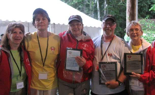 Volunteer extraordinaire awards presented by Gladys Berringer to Jean Stewart, June Hodgins, Randy Turk and Carol Mack.