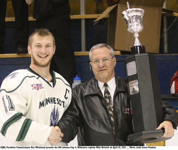 SIJHL most valuable player Mike Dietrich receives award from League President