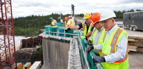 Minister Chiarelli overlooking the construction at Smokey Falls Generating Station in Lower Mattagami.