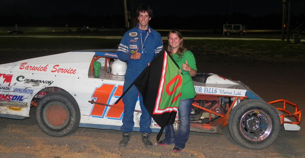 #17 Christopher Leek poses with Tasha McNally after winning the feature race in the WISSOTA Midwest Modifieds during the Keith McNally Memorial. Leek claimed his third championship in a row as well.