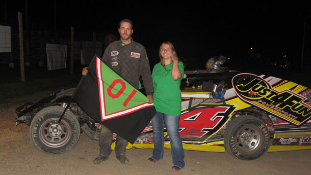 #4 Steve Nordin takes a picture with Tasha McNally after winning the WISSOTA Modified feature event.