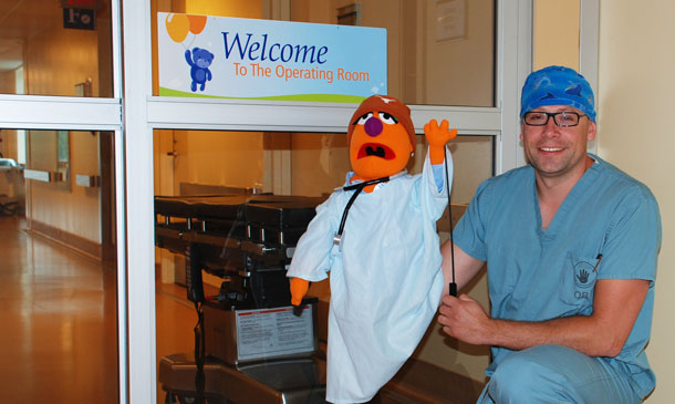 Dave Vincent, RN shows off Sam Purple, an interactive puppet, who helps acquaint children with the Operating Room during a tour, prior to their visit for surgery. Funding from a Family CARE Grant provided by the Thunder Bay Regional Health Sciences Foundation/Volunteer Association, allows children to bring home scrub-like pajamas after their tour finishes for a positive memory of the hospital