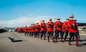 RCMP Officers march in Fort MacMurray during the Freedom of the City Centennial Event