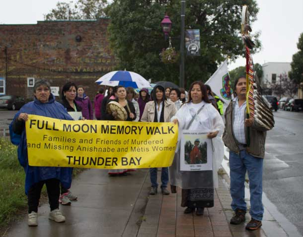 Walkers pause on Simpson Street during the 2013 Full Moon Memory Walk