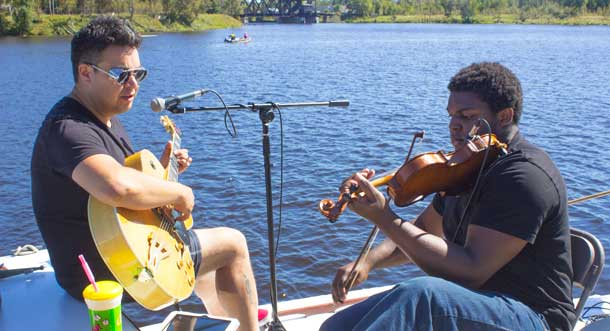 Music was aboard the Nina, a small motor cruiser owned by Paul Morralee a Kam River Park enthusiast