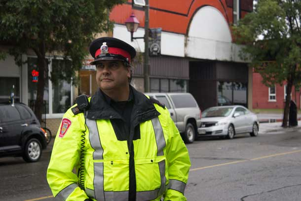 Constable John Walmark keeping a careful eye to safety to ensure the walkers are safe.