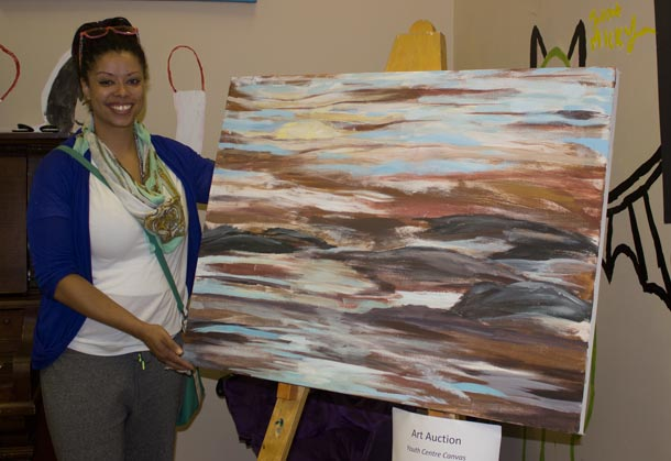 Youth Centre President Colleen Peters poses with one of the amazing art pieces at Youth Tbay