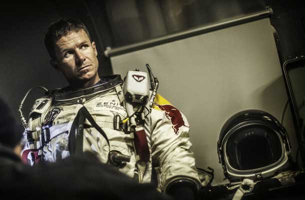 Nothing in Felix Baumgartner's career had ever been quite like the challenge of Red Bull Stratos. In this image, he is helped with the 100 pounds of equipment he wore on every flight by the team's life support engineer, Mike Todd. Photo - Red Bull Content Pool