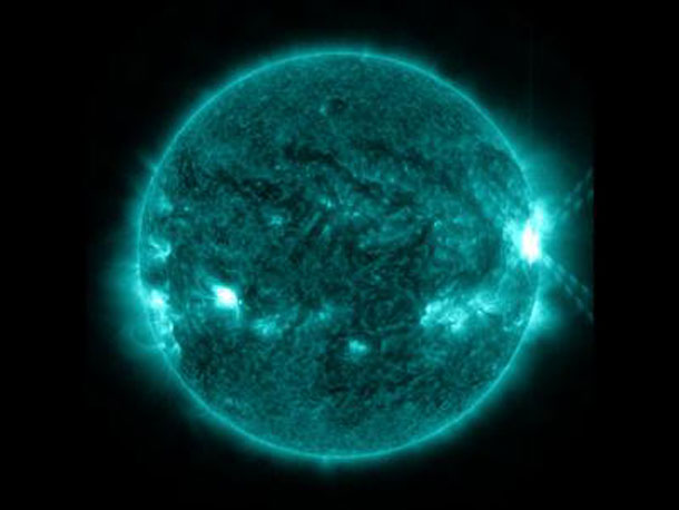 An X1.0-class flare exploded off the right side of the sun, peaking at 10:03 p.m. EDT on Oct. 27, 2013. This image was captured by NASA's Solar Dynamics Observatory in the 131 Angstrom wavelength, which is particularly good for showing solar flares and is typically colorized in teal. Credit: NASA/SDO