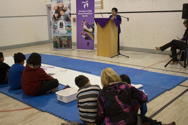 Painted purple feet were the order of the morning as youth helped kick off Child Abuse Prevention Month