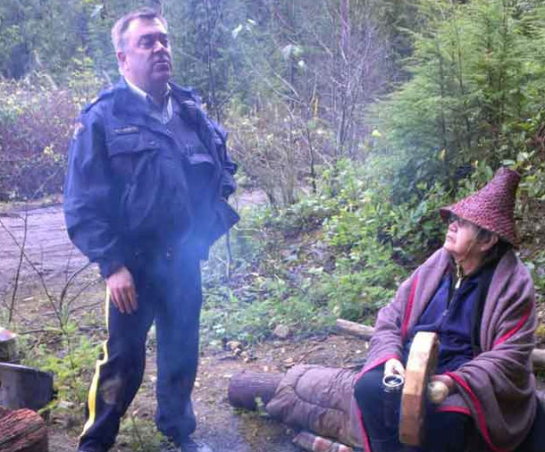 Xwu'p'a'lich Shishalh Elder sits at Sacred Fire being asked to leave by RCMP