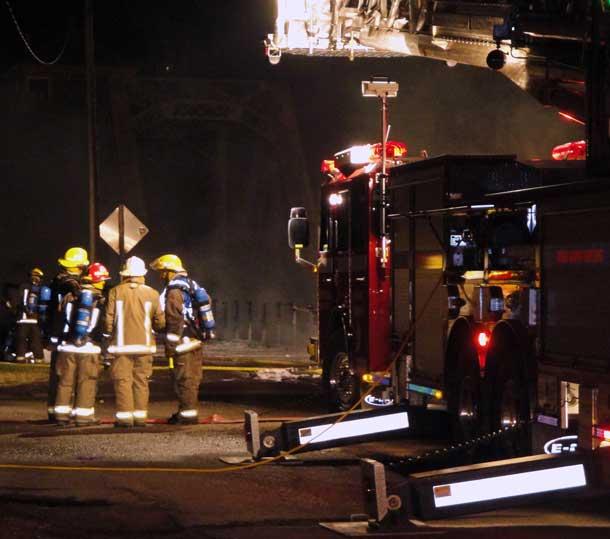 Firefighters assess the scene