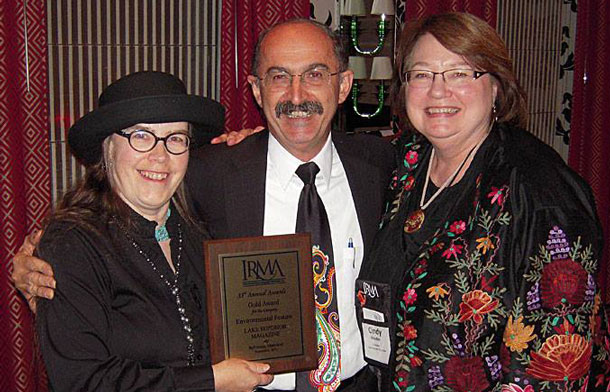 "Editor Konnie LeMay (left) and company president Cindy Hayden (right) accepted the Gold Award for best Environmental Feature from Samir ""Mr. Magazine"" Husni at the 2013 IRMA Awards in Baltimore."