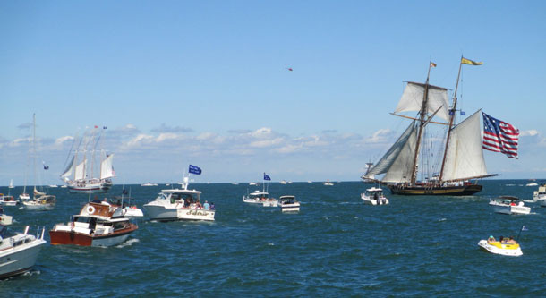 The 157-foot topsail schooner Pride of Baltimore II surrounded by spectator boats during the re-enactment of the Battle of Lake Erie where the tall ship portrayed the US Brig Caledonia. (Photo courtesy of Tall Ships America)