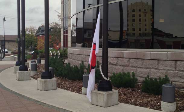 Poppy Flag raised at City Hall to remember and remind residents to wear a poppy.