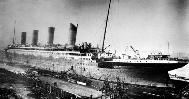 The RMS Titanic under construction. The ship, considered unsinkable hit an iceberg and sunk in 1912 with 1547 people being lost.