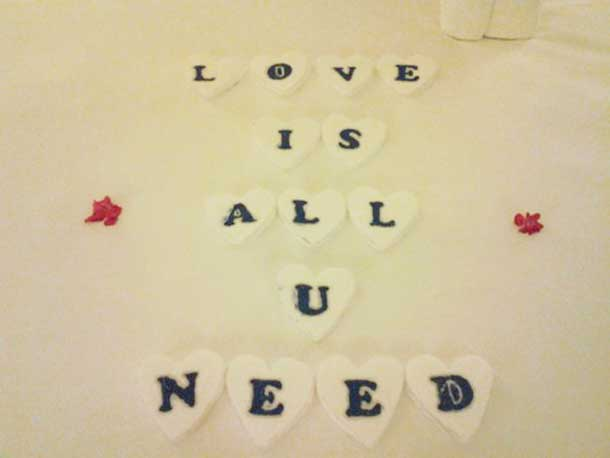 These letters were personally cut out of Styrofoam in heart shapes by my personal butler.  He expressed concern for some people's sensitivities to scents and wanted an alternative greeting to handpicked flowers from the resorts lavish gardens.