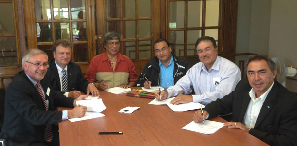 From left to right are Professor Lee Stuesser, Founding Dean of Lakehead University's Faculty of Law; Lakehead President and Vice-Chancellor Dr. Brian Stevenson; Deputy Grand Chief Goyce Kakegamic, Nishnawbe Aski Nation; Chief Gary Allen from Treaty #3 (signing on behalf of Grand Chief Warren White); Regional Grand Chief Peter Collins from the Union of Ontario Indians; and President Gary Lipinski from Métis Nation of Ontario.