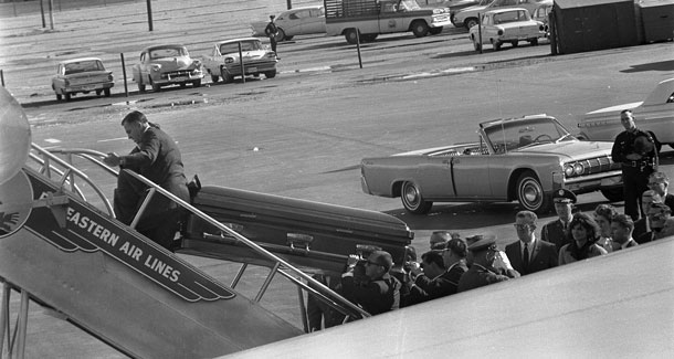 The body of President Kennedy in a coffin being loaded aboard Air Force One - John F. Kennedy Presidential Library