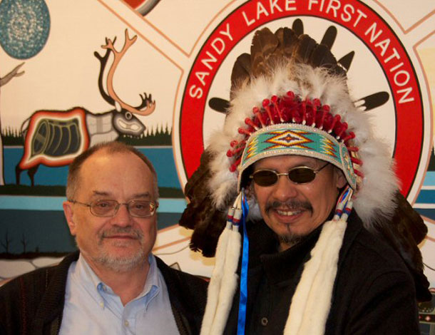 Chief Bart Meekis of Sandy Lake First Nation (right) and Blaine Webster of Goldeye Explorations Limited (left) with signed Exploration Agreement.