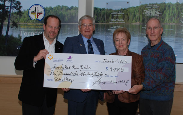 Sioux Lookout Meno Ya Win Health Centre was the grateful recipient of a grant for $9,435 from the Northern Cancer Fund of the Thunder Bay Regional Health Sciences Foundation to fund the purchase of a new triple channel IV pump for chemotherapy. Pictured, left to right, are: Glenn Craig, President & CEO, Thunder Bay Regional Health Sciences Foundation; Anthony Kadikoff, Board Director, Thunder Bay Regional Health Sciences Foundation; Marnie Houey, Chair, Board of Directors, Sioux Lookout Meno Ya Win Foundation; and Ed Linkewich, Board Director, Sioux Lookout Meno Ya Win Foundation.