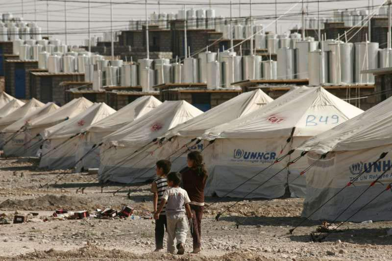 Three Syrian refugee children explore the new camp at Darashakran in northern Iraq. Photo: UNHCR/L. Veide