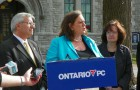 Lisa MacLeod, with Vic Fedeli speaking on energy policy.