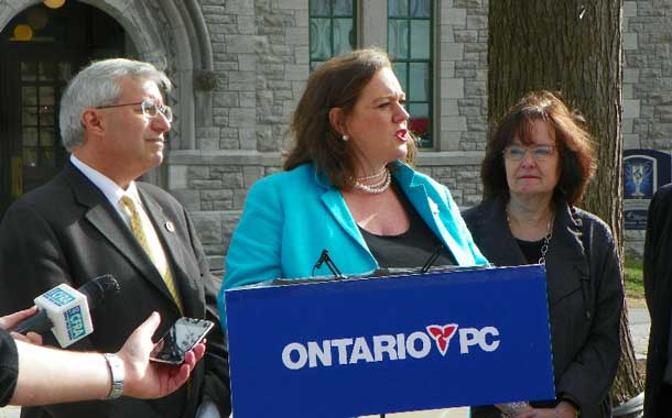 Lisa MacLeod, with Vic Fedeli speaking on energy policy.