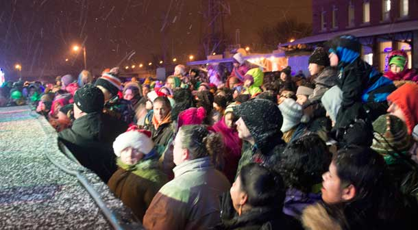 A huge crowd of enthusiastic  people crowd the stage at the CP Holiday Train.