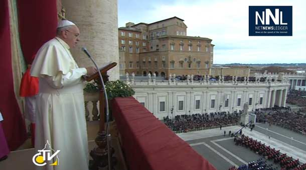 Pope Francis delivering message from balcony in the Vatican.