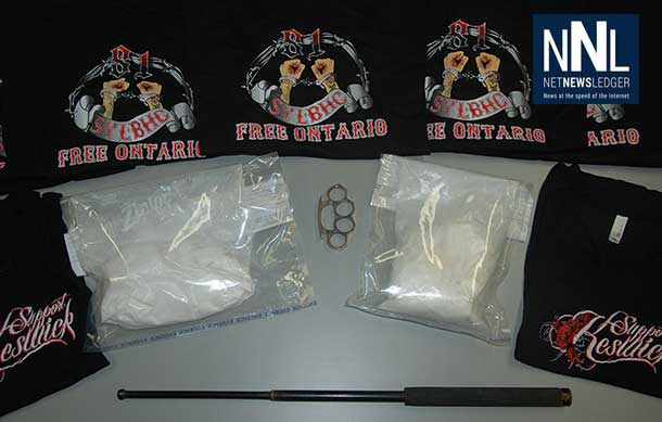 Two bags of cocaine, one set of brass knuckles, one extendable baton and numerous black shirts - RCMP Image