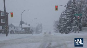 Red River Road and High Street, snow covering the road surface is causing slippery roads.