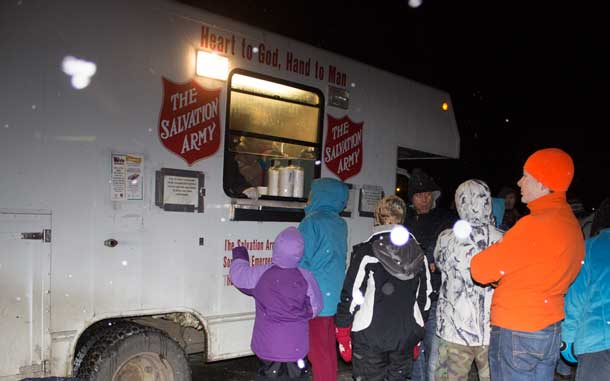 A chilly night in Thunder Bay at the CP Holiday Train - residents line up for some warmth.