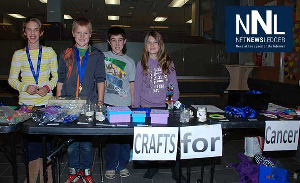 Woodcrest P.S. student Ben Mayes, 2nd from right, along with his friends, from left, Brooklyn Feletto, Parker Epp and Amanda Pike sold Crafts for Cancer during a recent Parent/Teacher Night at the school. Altogether they raised $100. Ben wanted to raise the funds in honour of his grandfather who is receiving cancer treatment.
