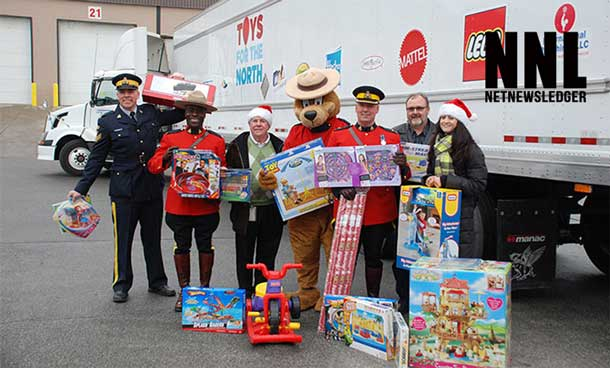 Thomson Terminals: November 26, 2013. L-R: Sgt. Richard Rollings, Cst. Stuart Philp, Gary Rodrigue (Thomson Terminals), Safety Bear, Insp. Gilmore, Al Russell, Laura Wiese (Canadian Toy Association)