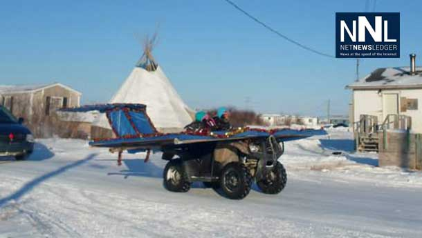 Contact.... contact... the airplane having fun in the Attawapiskat Christmas Parade. Photo by Rosiewoman Cree.