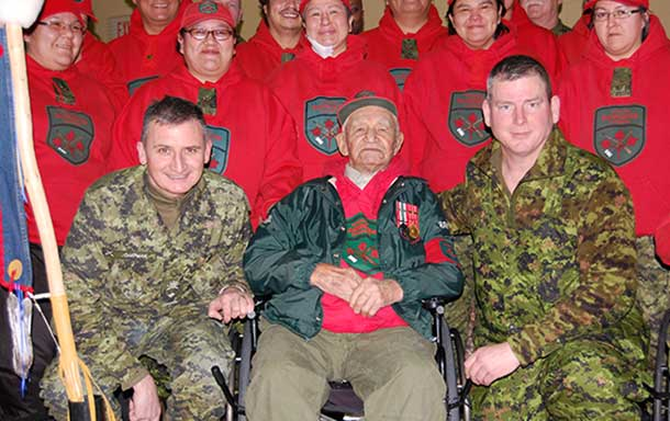 Ranger Abraham Metawabin is surrounded by fellow Canadian Rangers and military officers after receiving a first bar to his Canadian Forces Decoration for his long military service. Photo: Captain Robert Munroe, Canadian Rangers