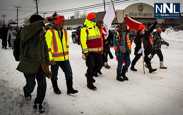 """The Walkers"" appear to be smitten with the high level of adulation and warm response from the community of Moosonee upon their arrival. — in Moosonee. Photo by Chris Kat."